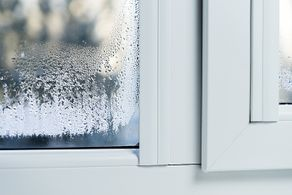 Double-glazed windows with thermal profiling